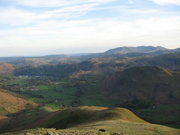 Seat Sandal's south ridge with the Coniston Fells in the distance (right)