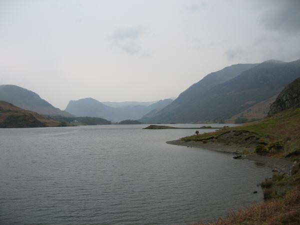 Low Ling Crag sticking out into Crummock Water with Fleetwith Pike in the distance