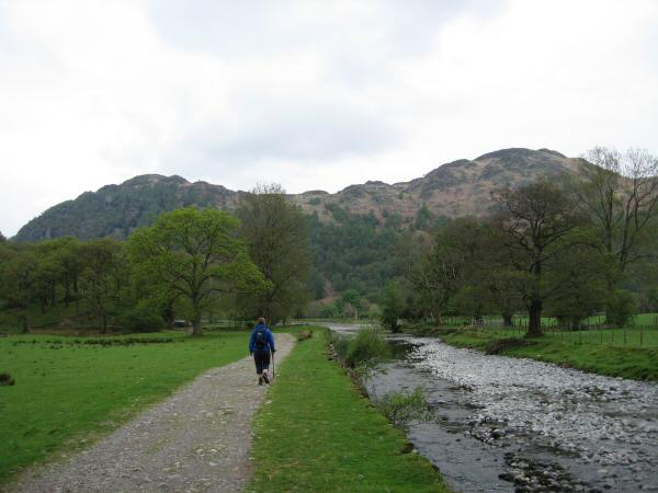 Walking along the side of the River Derwent with Grange Fell ahead