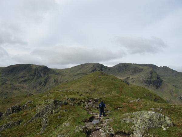 Heading along the ridge with Dove Crag, Hart Crag and Fairfield on the skyline