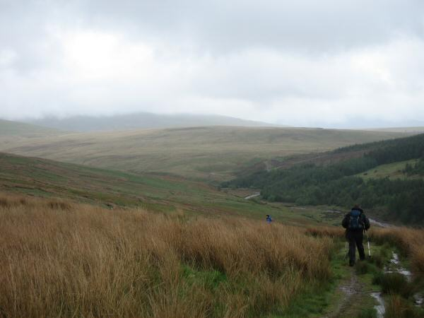 Heading along a track above Worm Gill on our way to Caw Fell