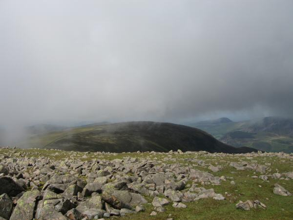 Iron Crag appears as the cloud starts to lift and break (From Caw Fell's summit)