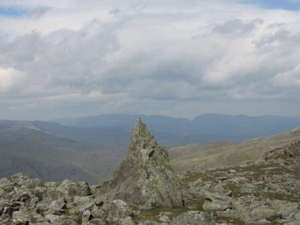 The 'Matterhorn Rock' on Grey Friar with the Helvellyn ridge and Fairfield in the distance