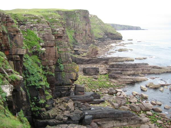 Sea cliffs with the Point of Stoer in the distance