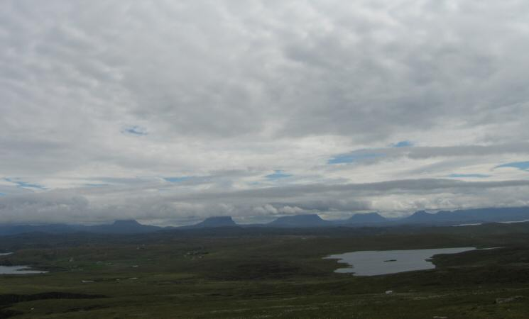Looking inland to the mountains of Assynt and Coigach with their tops in cloud