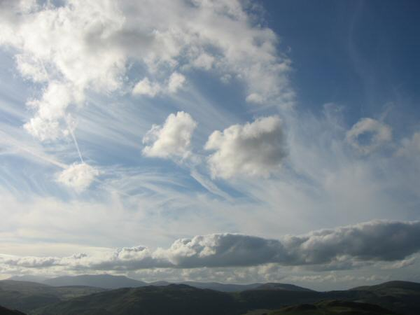 The sky above Gowbarrow Fell with Blencathra in the distance on the left