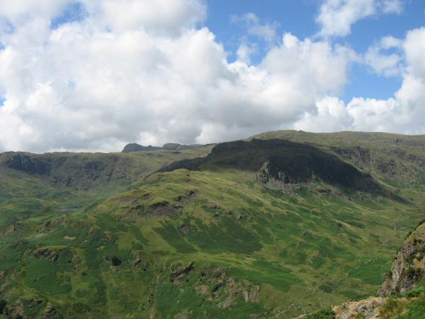 Cloud shadow over Tarn Crag with Harrison Stickle coming into view behind and above the Blea Rigg ridge