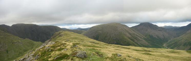 Yewbarrow's north top from the main top with Pillar, Kirk Fell and Great Gable behind