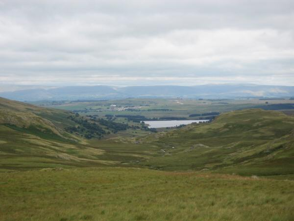 Wet Sleddale Reservoir with the North Pennines in the distance from Ulthwaite Rigg's summit