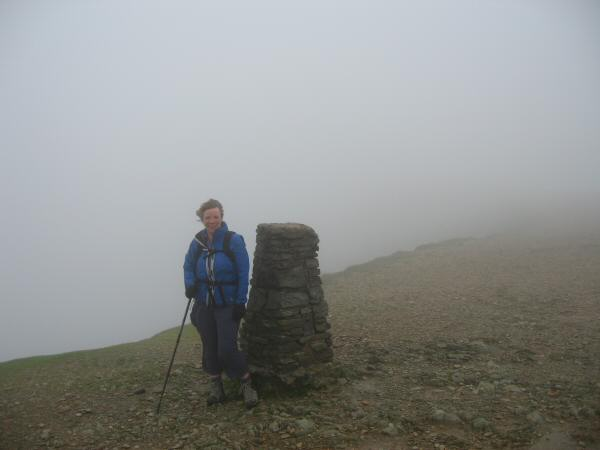 Anne at the trig point on Helvellyn's summit