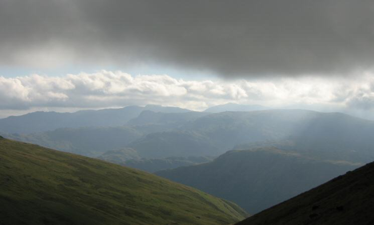 The view west with Bowfell and Scafell Pike clear of the cloud