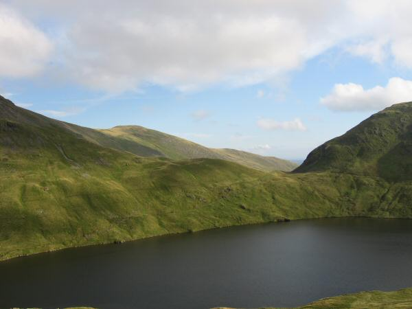 Looking across Grisedale Tarn to Great Rigg and Grisedale Hause