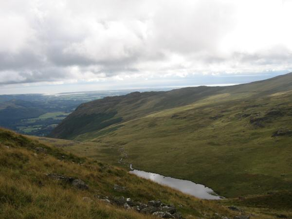 Looking over Greendale Tarn to Buckbarrow from the ascent of Middle Fell