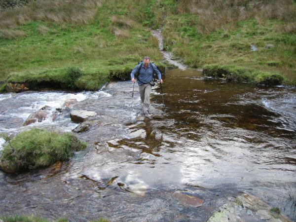 Crossing Mosedale Beck with the stepping stones underwater!