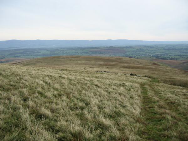 Looking back down on The Pen with the North Pennines in the distance from Loadpot Hill