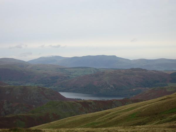 A glimpse of Ullswater with Blencathra on the skyline and a touch of cloud on Skiddaw (left)
