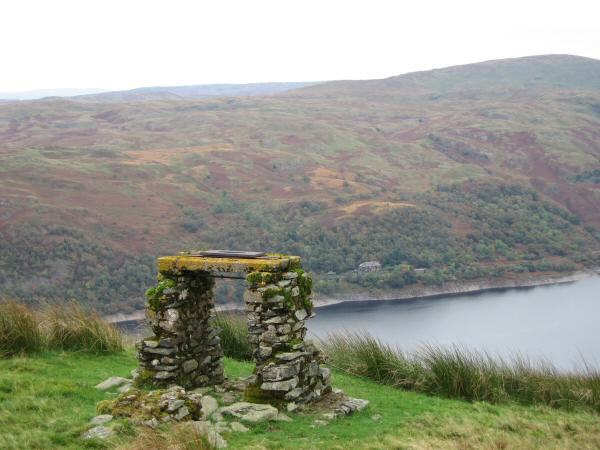 The remains of a survey point above Lad Crags. The Haweswater Hotel can be seen on the far side of the reservoir