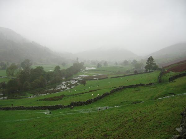 Flooded fields and Troutbeck Tongue just visible in the cloud ahead
