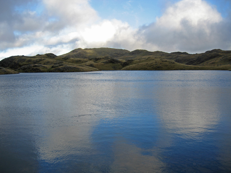 Sprinkling Tarn. The high point on the skyline is Glaramara