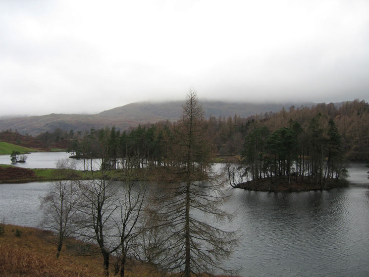 Tarn Hows with the top of Wetherlam in cloud