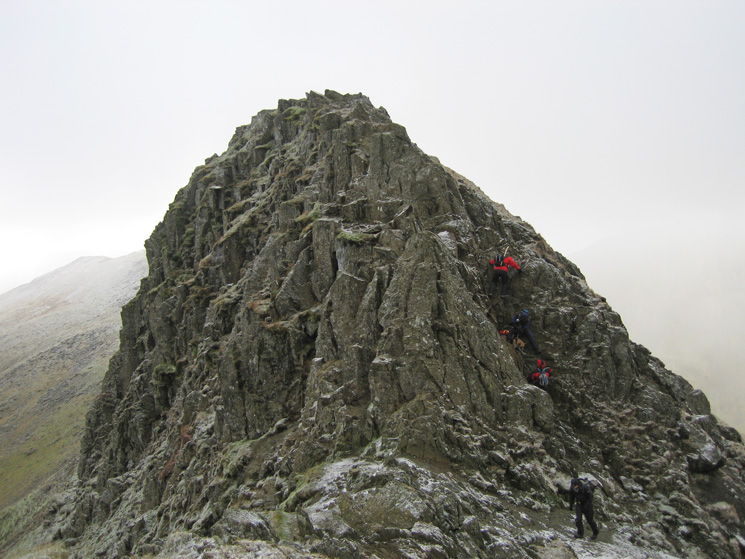 Walkers (and dog) descending the short gully at the end of Striding Edge