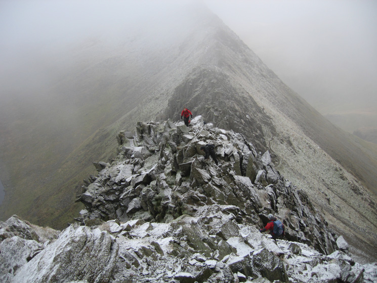 A light dusting of snow on the ascent to Helvellyn summit from Striding Edge