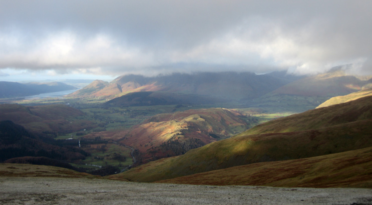 High Rigg catching some sun with the Skiddaw fells in cloud behind