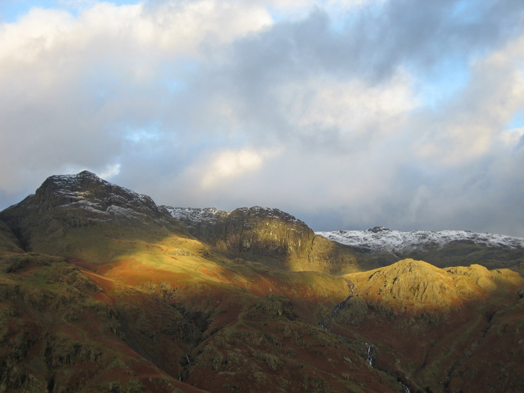 Harrision Stickle, Pavey Ark and Sergeant Man with the sun lighting up Tarn Crag