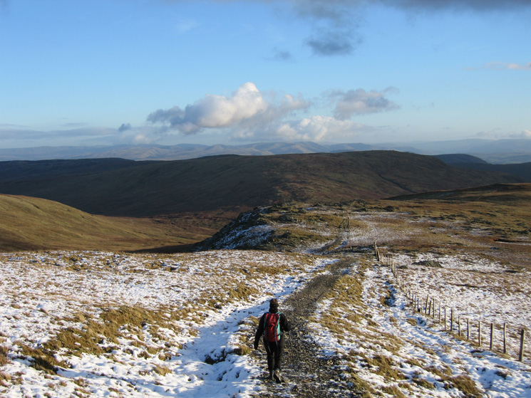 On the path to Gatescarth Pass with Tarn Crag ahead and the Howgills in the distance
