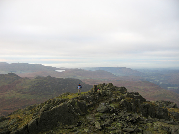 Harter Fell's 'official' summit from its true summit with Devoke Water in the distance