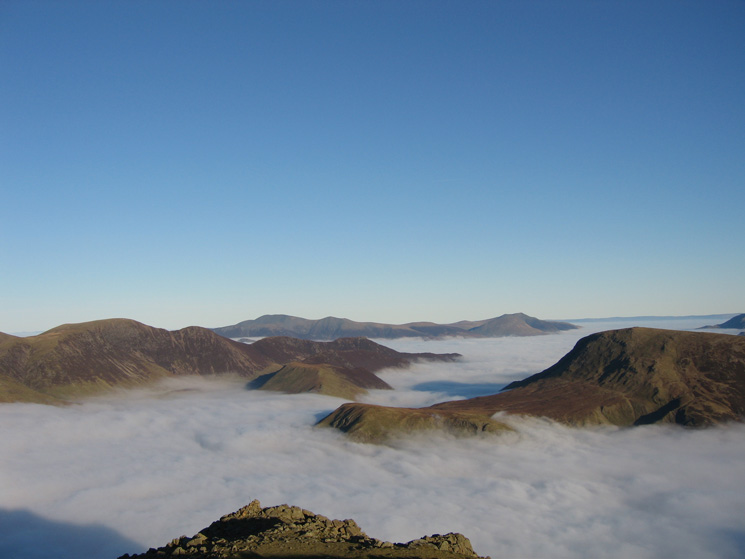 The Eel Crag to Causey Pike ridge on the left, Robinson on the right and Skiddaw and Blencathra in the distance from High Stile