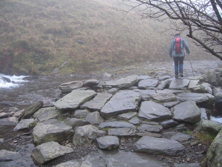 The slate slabs bridge across Roughten Gill