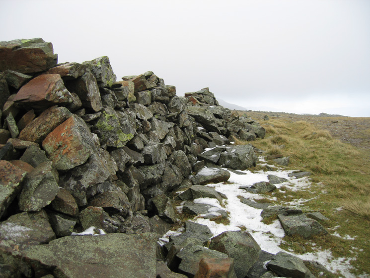 Part of the wall and a very small patch of snow at Dove Crag's summit
