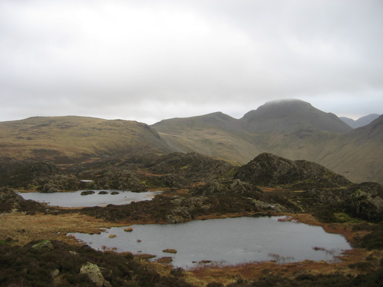 A nameless tarn with Innominate Tarn behind