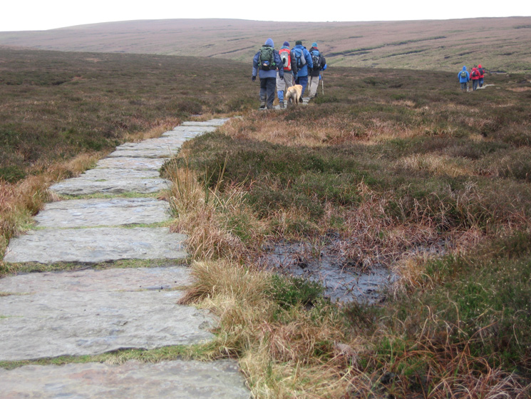 Heading along the paving slabs to Odgen Clough