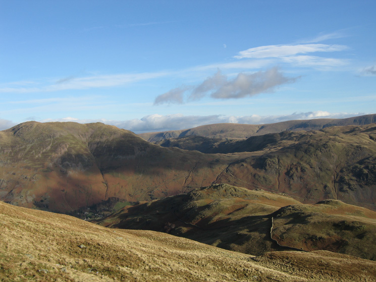 Looking back down on Arnison Crag with the far eastern fells behind