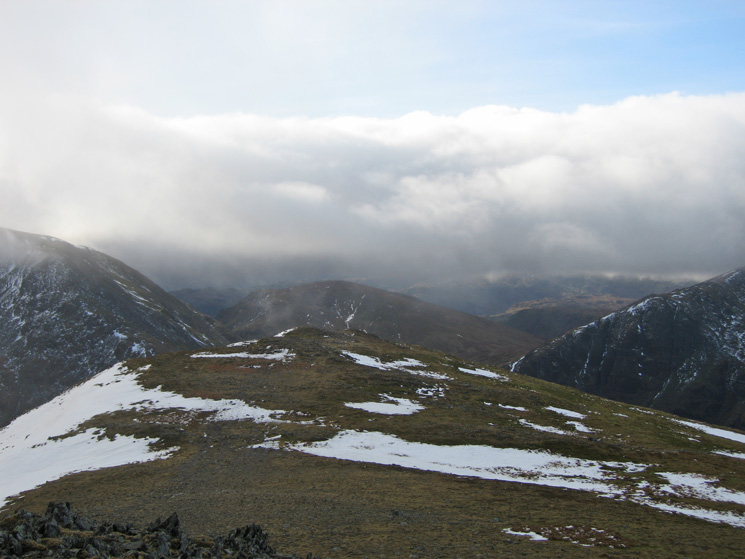 The cloudy view west from Saint Sunday Crag's summit