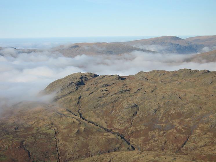 Zooming in on Hard Knott from Grey Friar's summit with Seatallan beyond