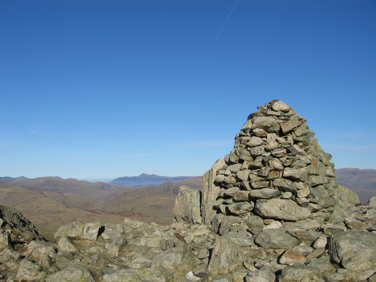 Swirl How summit cairn with Skiddaw in the distance