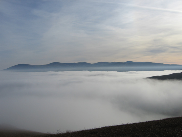 The Vale of Keswick filled with cloud and the Helvellyn range from Kinn