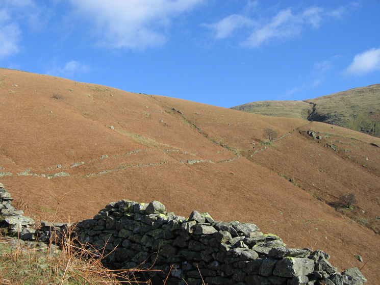 Our route followed a path between the two walls across the fellside before ascending back left to Stone Arthur's summit