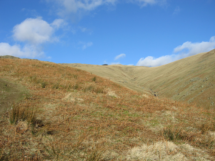The head of Greenhead Gill, the dark fell on the skyline (middle) is Great Rigg