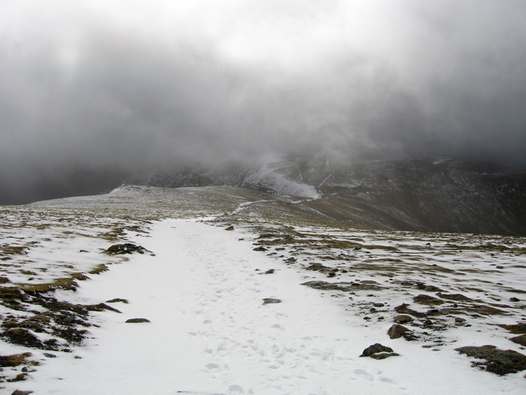 The path to Swallow Scarth and Nethermost Pike from Helvellyn's summit