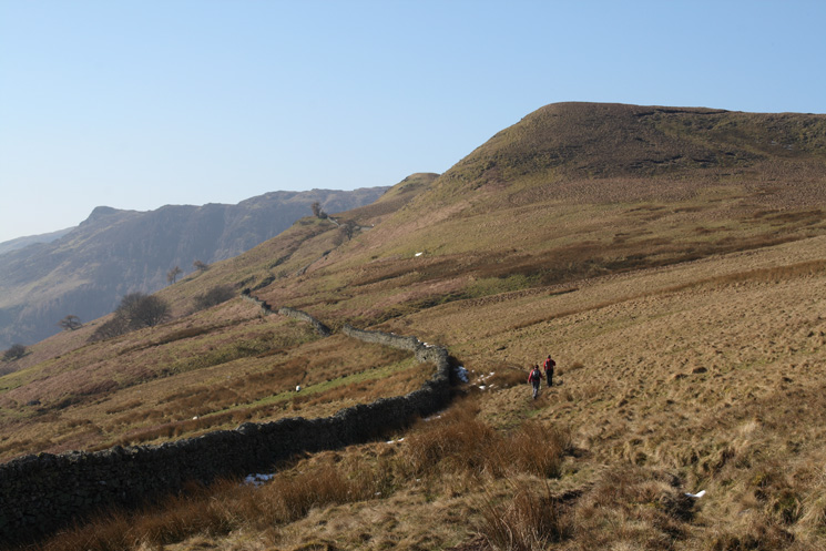 The path follows the wall passing under Swineside Knott
