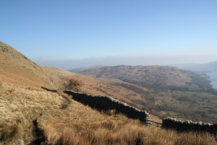 Looking back along the wall with Gowbarrow Fell and Ullswater on the right