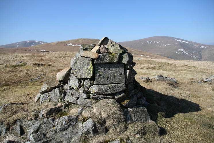 Birkett Fell's summit cairn with Stybarrow Dodd, Hart Side and Great Dodd behind