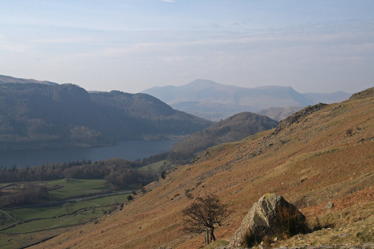 Thirlmere with Raven Crag behind, the wooded conical Great How with Skiddaw behind
