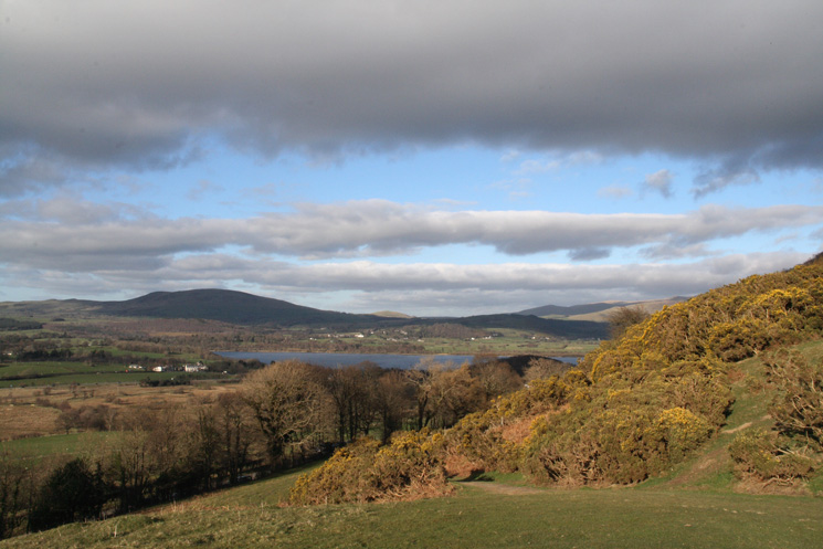 A glimpse of Bassenthwaite Lake and Binsey in shadow from above Wythop Church