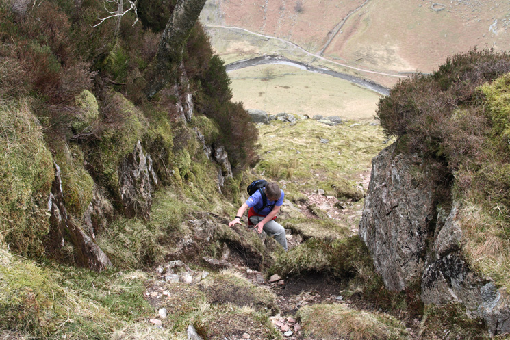 Ascending the short gully above the stile