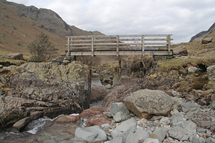 The footbridge over Langstrath Beck at Tray Dub